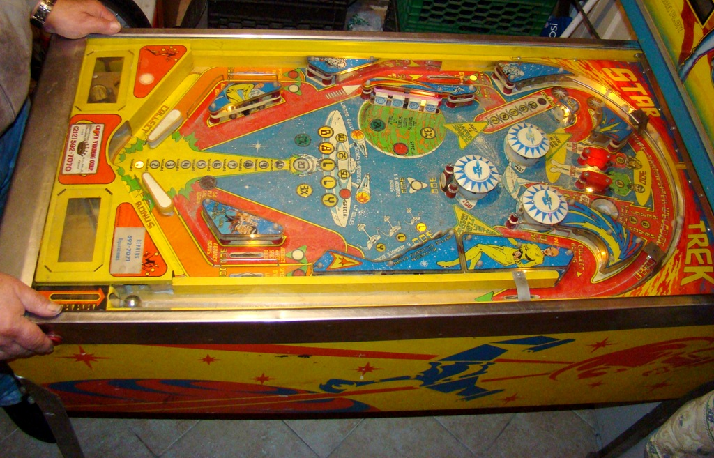 1978 star trek pinball machine with artist signature on bottom right of backing (1)